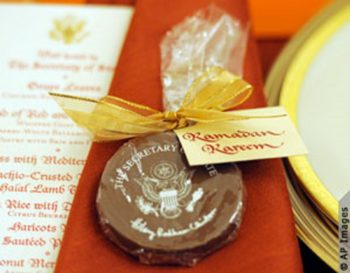 A menu and place setting, including an edible State Department seal, for the 2010 State Department iftar to celebrate the end of Ramadan (Photo Credits: AP Images)